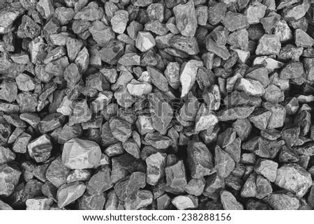 Texture of dark gray granite gravel