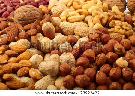 texture of different kinds of nuts - stock photo