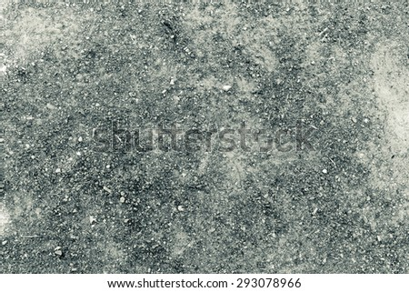 Texture of dry red clay with stones in black and white - stock photo