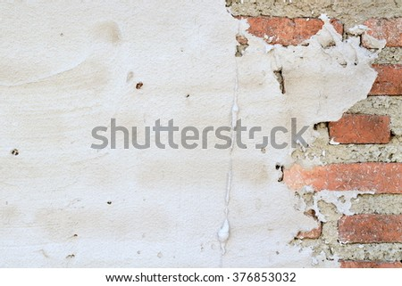 Texture of exterior brick wall under construction for background
