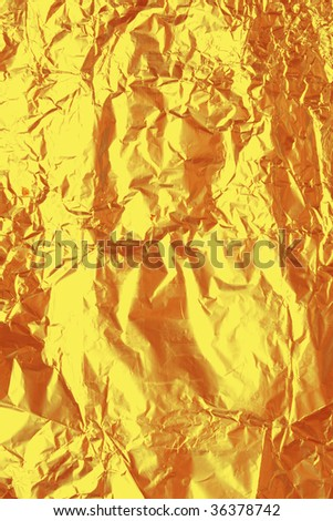 texture of golden foil close up view - stock photo