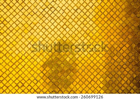 texture of golden mosaic from a thai temple - stock photo