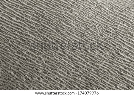 Texture of gray toilet paper, close-up, macro. - stock photo