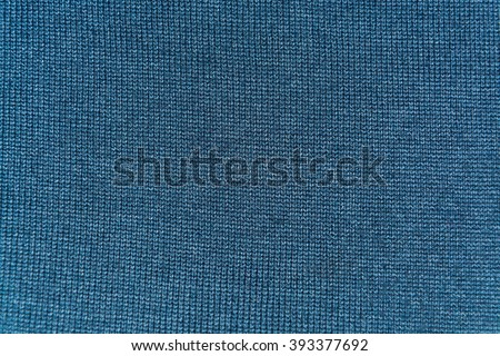 texture of gray woolen knitted fabric - stock photo