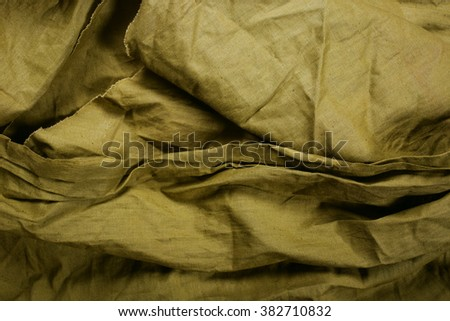 Texture of green military cloth - stock photo