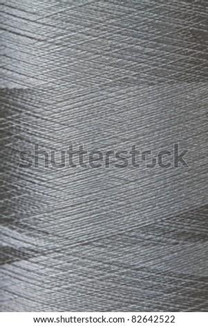 texture of grey thread in spool - stock photo