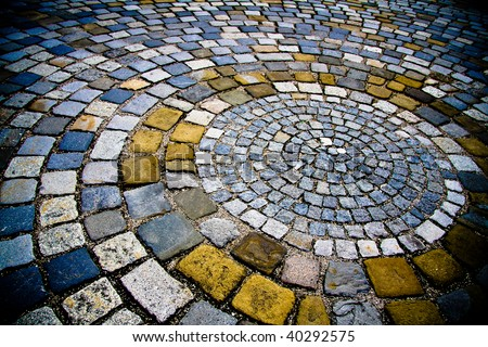 Texture of ground with colorful stones.
