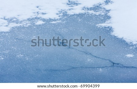 Texture of ice with snow - stock photo