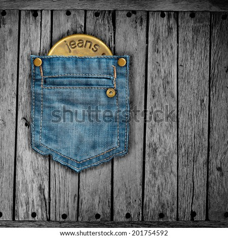 Texture of jeans on the wood. - stock photo