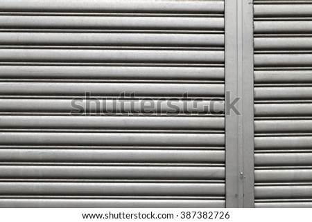 Texture of metal roll door - stock photo