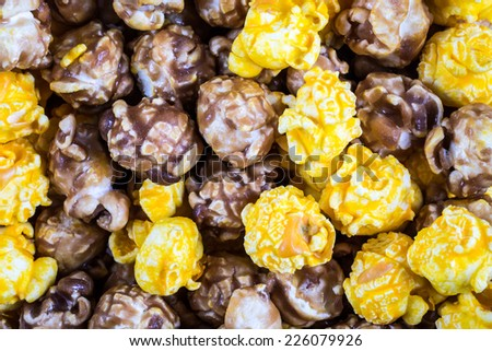 Texture of mixed cheese and caramel popcorn - stock photo