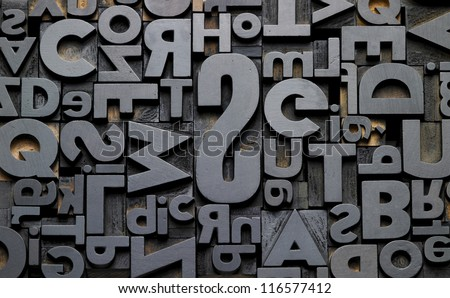 texture of old typefaces in composition - stock photo