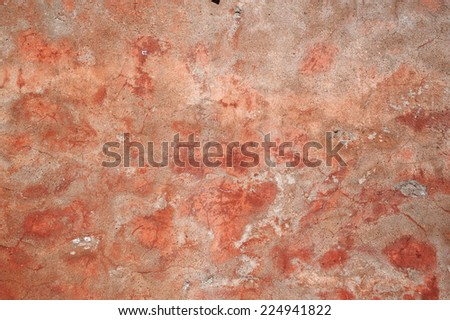 Texture of old wall covered with pink stucco