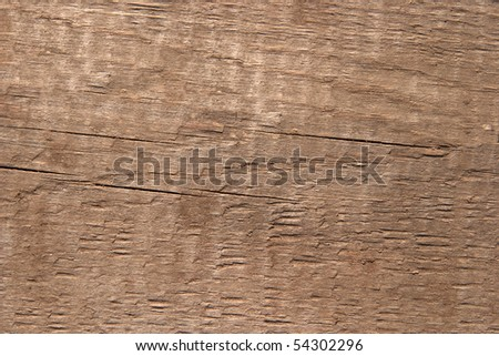 Texture of old wood. The hard side light reveals texture. One can see traces of rough handling and small cracks. Color of old noble wood. For any designer's use. - stock photo