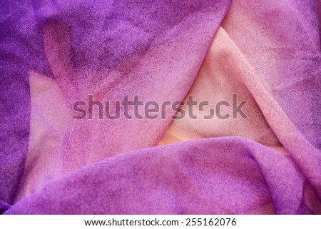 Texture of purple fabric with pleats. Shallow depth of field - stock photo