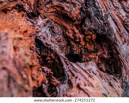 Texture of red volcanic stone made after solidification of lava, detailed view