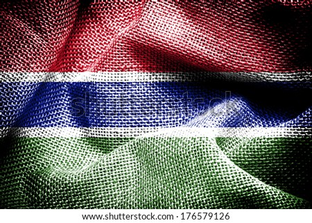 Texture of sackcloth with the image of the Gambia Flag - stock photo