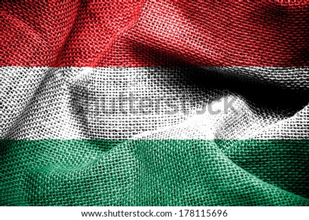 Texture of sackcloth with the image of the Hungary Flag.  - stock photo