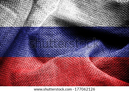 Texture of sackcloth with the image of the Russia flag.  - stock photo