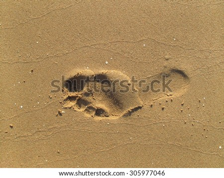 Texture of sand with footprint                    - stock photo