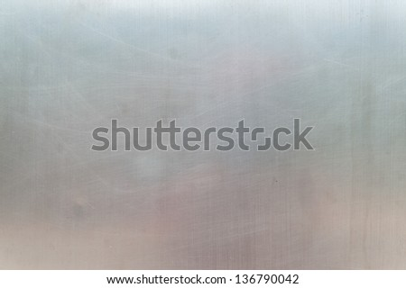 Texture of scratched mat metal wall - stock photo