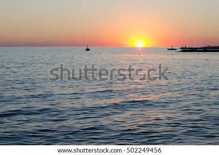 Texture of sea water at sunset, blue and orange colors of sun path