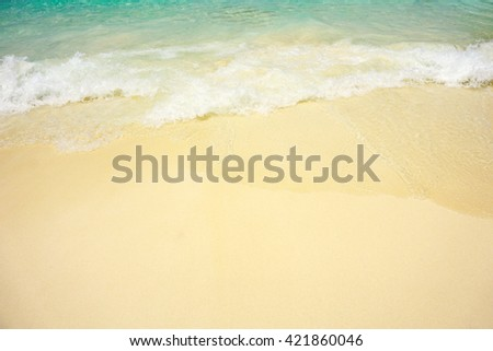 Texture of soft wave on the sand scenery beach. - stock photo