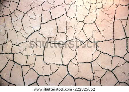 texture of the crackled white clay in the desert - stock photo