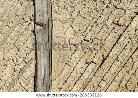 Texture of the old adobe walls, old plaster, retro construction technology of the 18th century country house - stock photo