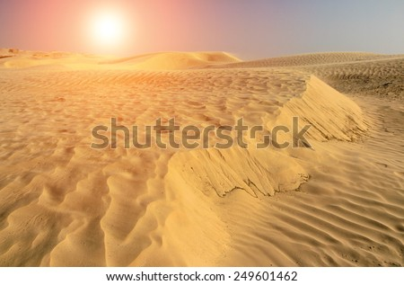 Texture of the sand in the desert of Sahara at sunset, Tunisia. - stock photo