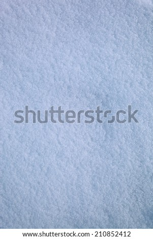 Texture of the snow surface as background. - stock photo