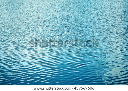 Texture of the water with waves or ripples for your background or design, vintage toned - stock photo