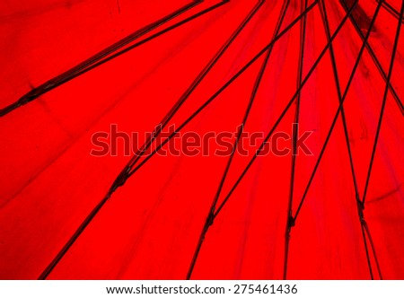 Texture of under red umbrella  - stock photo