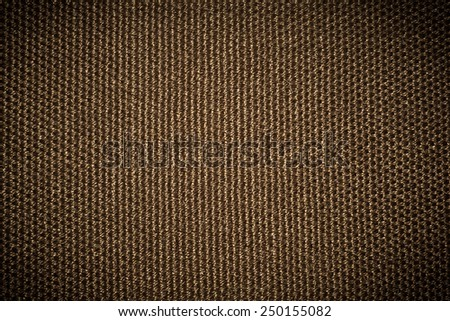 Texture of vintage brown seamless fabric pattern vignet background - stock photo