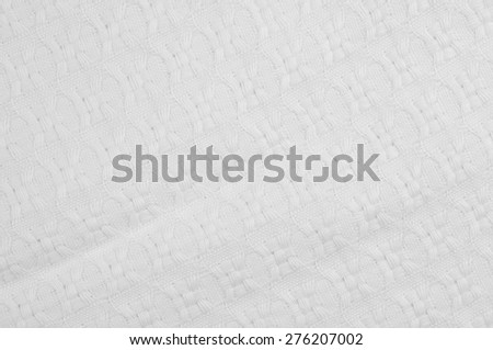 texture of white woolen cloth. Background or texture of white fabric closeup. - stock photo