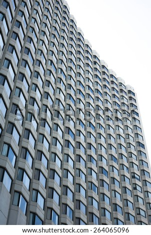 texture of windows and facades - highrise apartment condominium reflections construction - stock photo