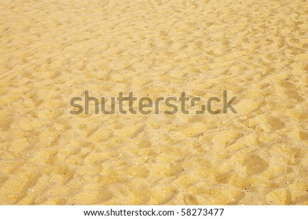 texture of yellow sand on the beach - stock photo