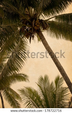 Texture overlay is applied to to a trio of 3 palm trees - stock photo