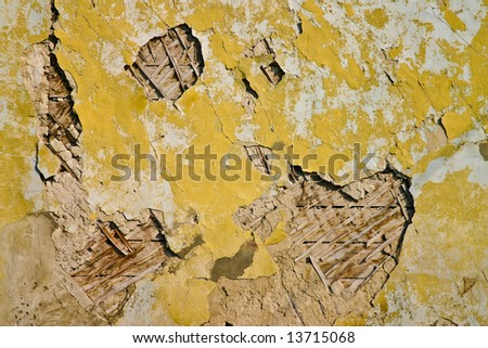 texture series: old cracked wall with yellow paint
