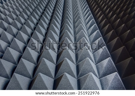 Texture soundproof panels in perspective. Triangles of the same shape of a special sound-absorbing polymer material gray. High-tech background. - stock photo