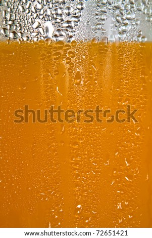 Texture water drops on the glass of juice. - stock photo
