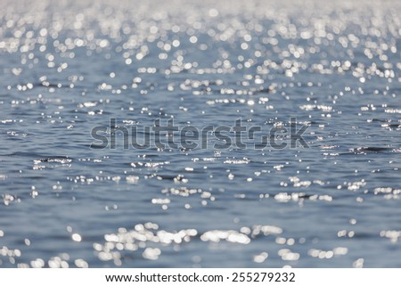 Texture water with small waves of blue - stock photo