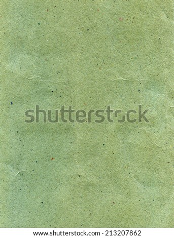 Textured aged dirty grainy green vintage paper retro background - stock photo