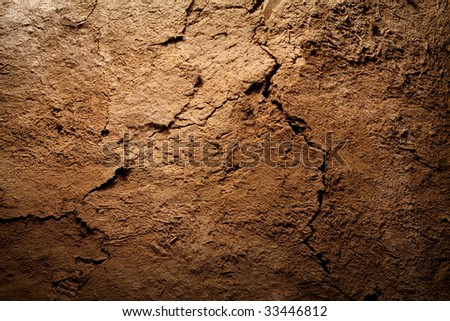 Textured background - dry cracked brown earth - stock photo