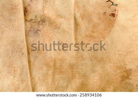 Textured background image made of a weathered old leather chair - stock photo