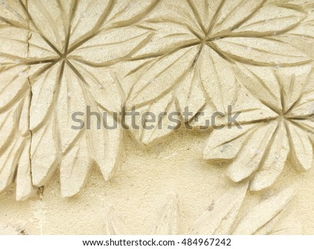 Textured background : traditional handcraft decoration of flowers on sandstone