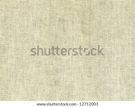 Textured beige colored textile background - stock photo