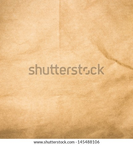 Textured brown  recycled vintage natural  paper. Useful as background. - stock photo