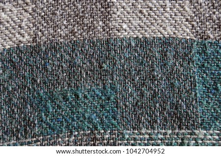 Textured cloth green and gray backgrounds.