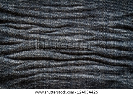 Textured creased denim striped jeans background
